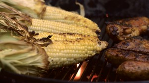 Detail picture of corn and chicken browning on the grill