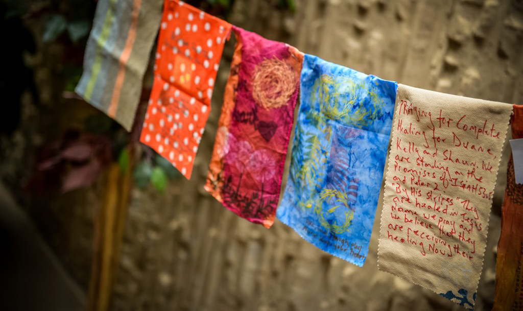 Prayer flags hanging in a natural space