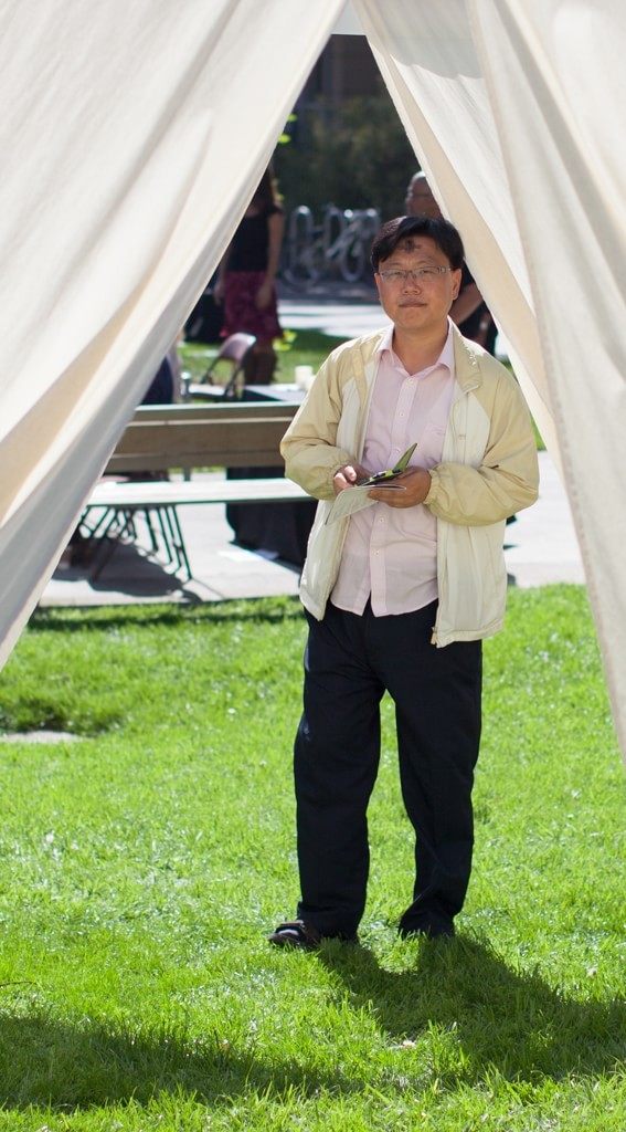 A community member passes through the Stillness Tent, built on Fuller Pasadena's campus