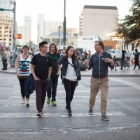 Fuller Seminary students walk with Brehm Program Director Nate Risdon at SXSW