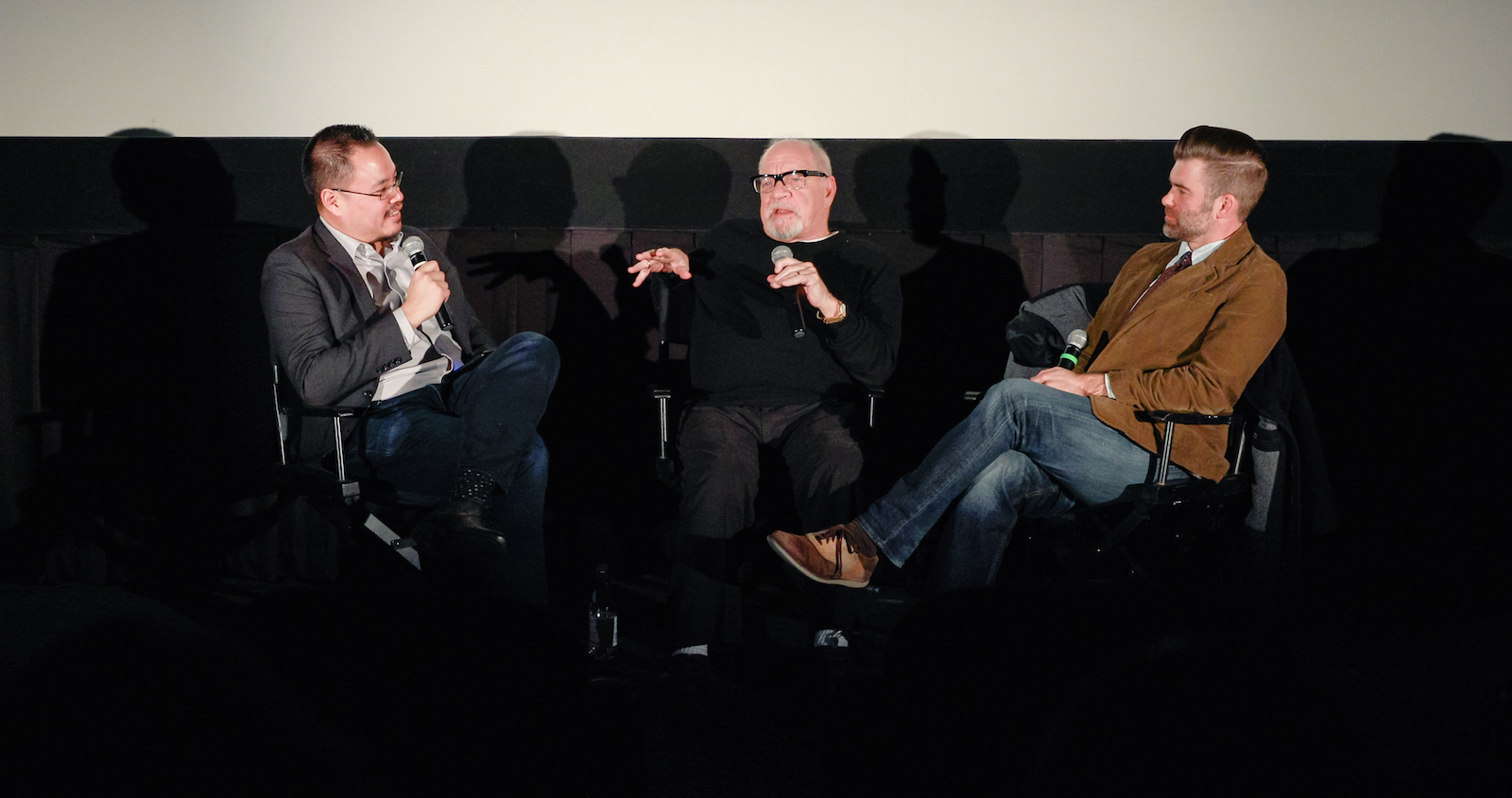Justin Chang, Paul Schrader, and Kutter Callaway discussing First Reformed