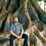 man sitting on roots