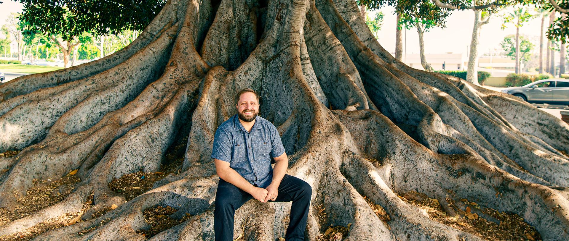 man sitting on roots